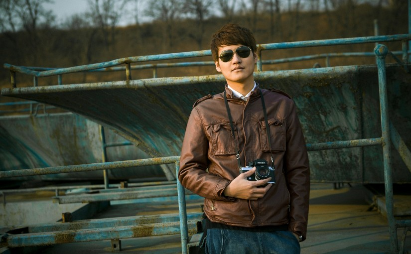 Man with camera and sunglasses
